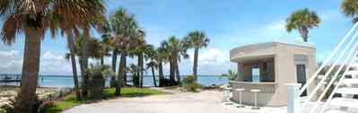 Navarre:-7332-Grand-Navarre-Blvd_03.jpg:  cabana, stairs, palm trees, santa rosa sound