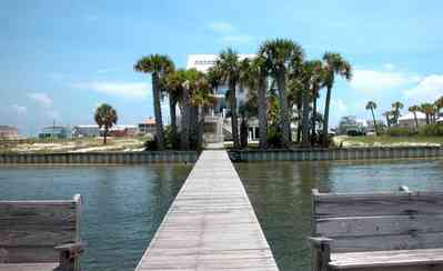 Navarre:-7332-Grand-Navarre-Blvd_07.jpg:  santa rosa sound, palm trees, dock, deck, sand dunes