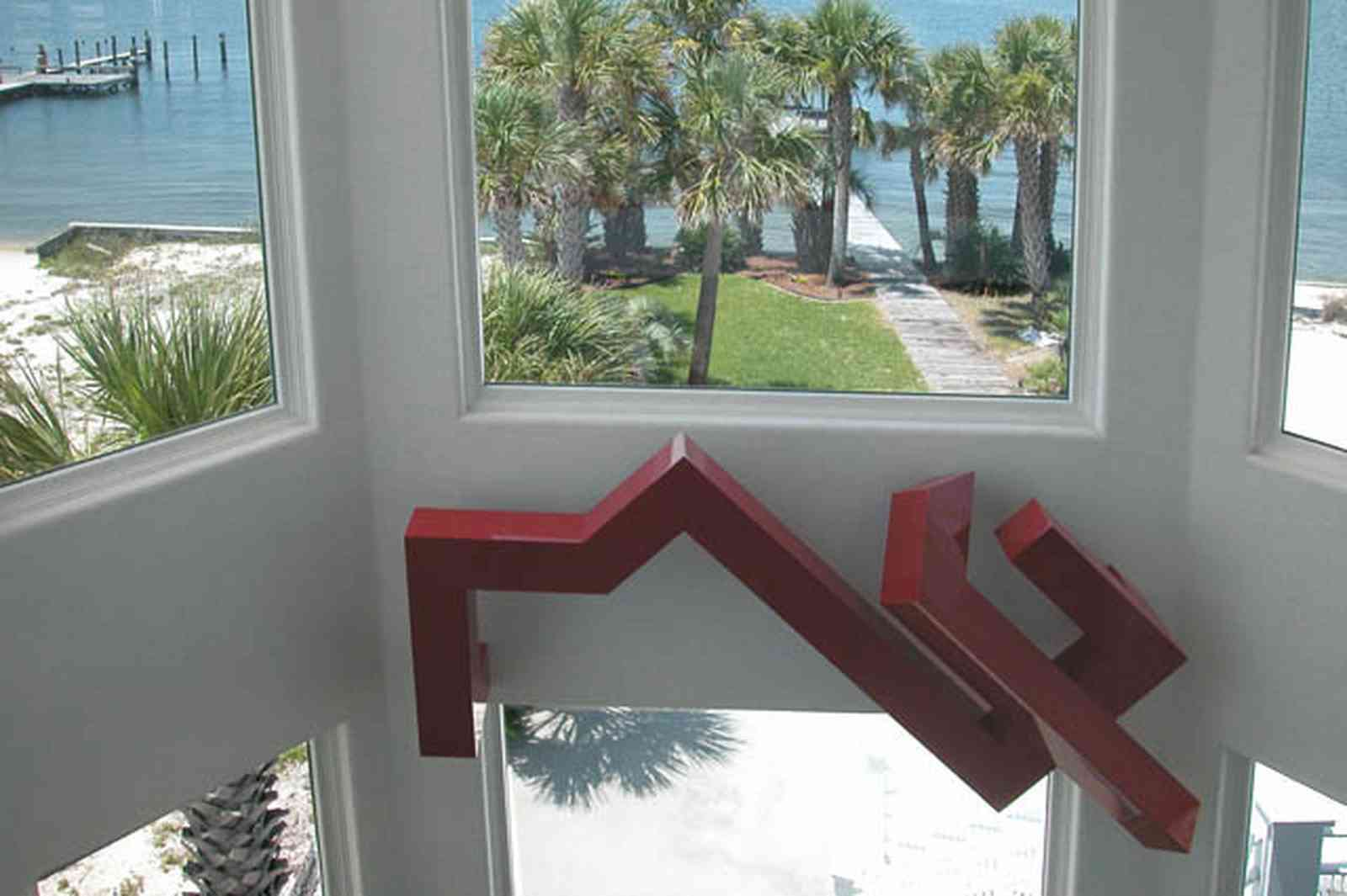 Navarre:-7332-Grand-Navarre-Blvd_10.jpg:  art deco house, view of bay, santa rosa sound, pier, dock, deck, window, sculpture