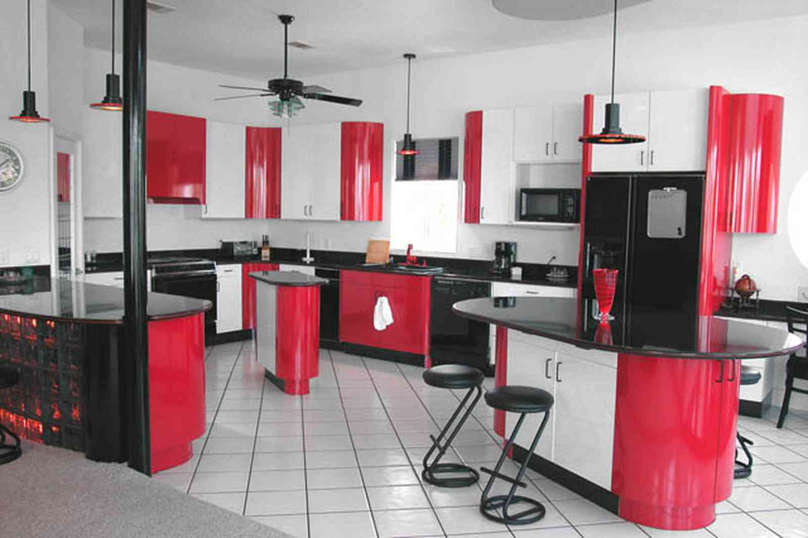 Navarre:-7332-Grand-Navarre-Blvd_21.jpg:  red lacquer cabinets, red and black, art deco decor, art deco house, kitchen, red kitchen cabinets, glass brick bar, ceiling fan, black laquer cabinets