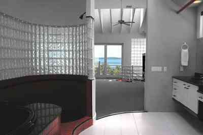Navarre:-7332-Grand-Navarre-Blvd_51.jpg:  art deco house, bathroom, glass brick wall, skylight, black laquer cabinets