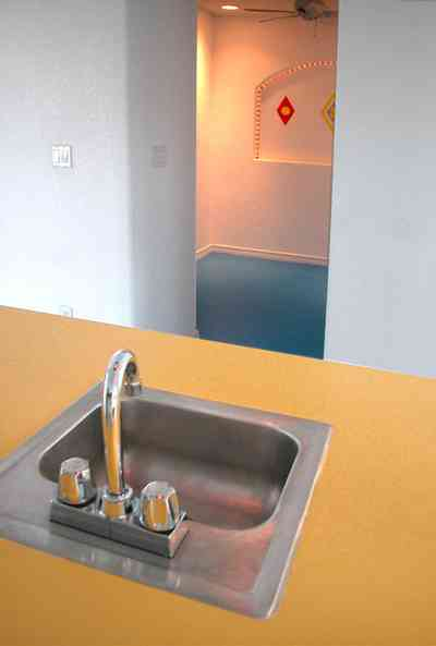 Navarre:-7332-Grand-Navarre-Blvd_64.jpg:  bar sink, yellow counter, blue floor, art deco design, art deco house