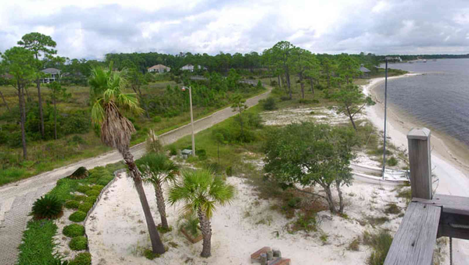 Navarre:-Biscayne-Pointe-Drive-House_12.jpg:  wetland, escambia bay, palm tree, sand shore pine tree, house deck, bridge
