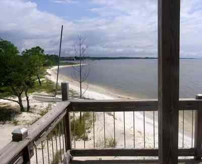 Navarre:-Biscayne-Pointe-Drive-House_13.jpg:  santa rosa sound, sail boat, deck, porch, sand water, pine tree, shoreline