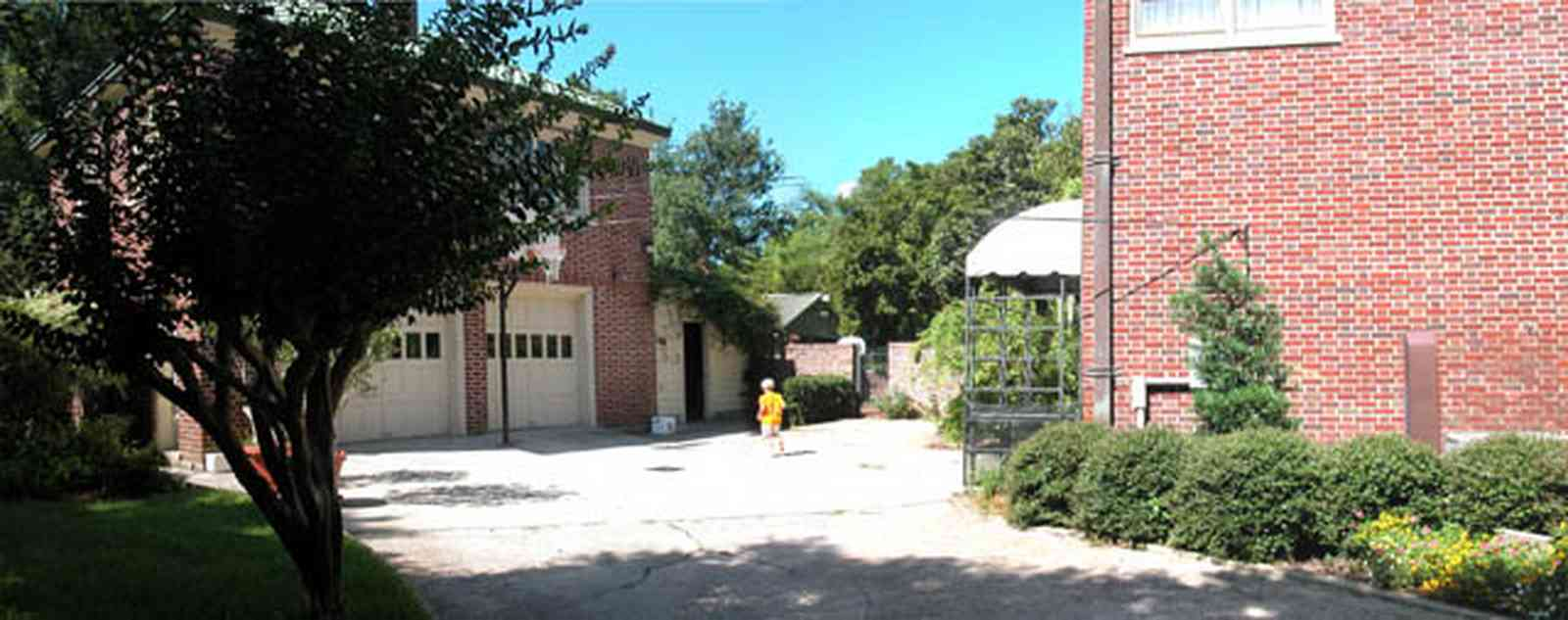 North-Hill:-105-West-Gonzales-Street_10c.jpg:  red brick house, carriage house, garage, crepe myrtle tree, french colonial architecture