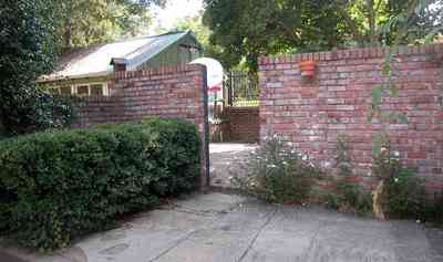North-Hill:-105-West-Gonzales-Street_20b.jpg:  greenhouse, garden house, brick wall, patio, oak tree, hedge