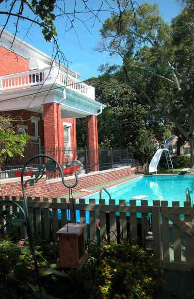 North-Hill:-105-West-Gonzales-Street_21.jpg:  swimming pool, slide, picket fence, bird house, wrought iron fence