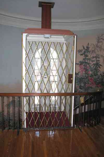 North-Hill:-105-West-Gonzales-Street_29a.jpg:  wallpaper, elevator, staircase, spiral staircase, second floor, hardwood floor