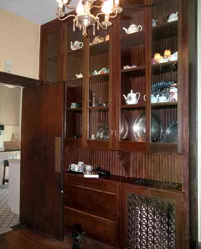 North-Hill:-105-West-Gonzales-Street_40.jpg:  china cabinet, silver platters, radiator, butlers pantry, kitchen