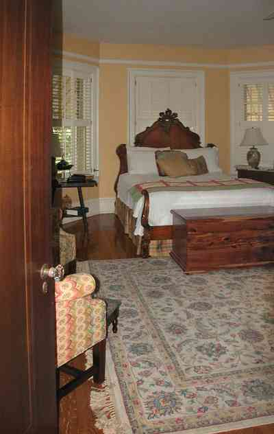 North-Hill:-105-West-Gonzales-Street_63.jpg:  antique bed, cedar chest, oriental rug, shutters, awnings wainscotting, hardwood floor