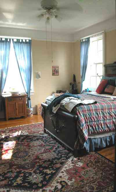 North-Hill:-105-West-Gonzales-Street_64.jpg:  oriental rug, sleigh bed, drapes, antique furniture, quilt, hardwood floor
