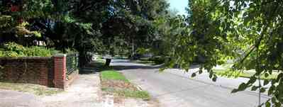 North-Hill:-105-West-Gonzales-Street_72.jpg:  brick fence, wrought iron fence, oak tree, neighborhood, service alley