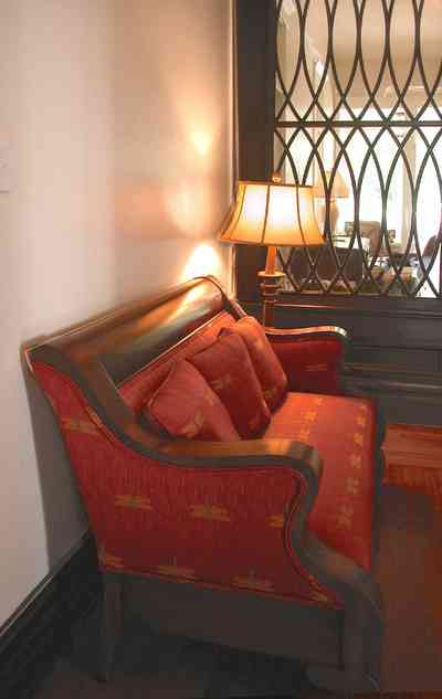 North-Hill:-116-DeSoto-St_02d.jpg:  red brocade sofa, central hall, floor lamp, heartpine flooring