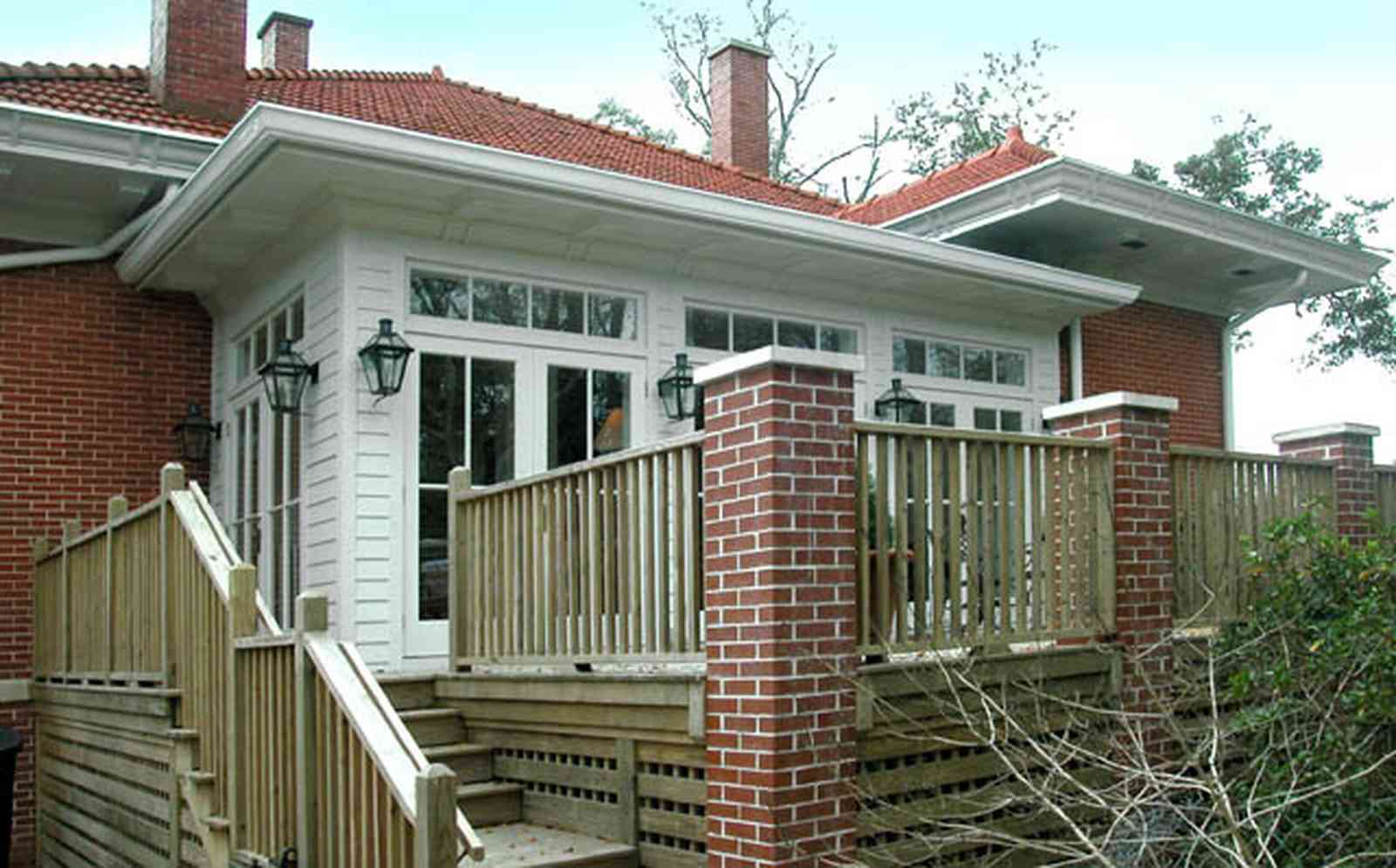 North-Hill:-116-DeSoto-St_03a.jpg:  brick pillars, french doors, back porch, transom, chimney, deck