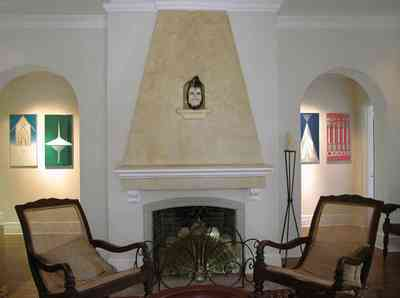 North-Hill:-123-West-Lloyd-Street_06.jpg:  fireplace, archway, arcade, stucco walls, cane backed chairs