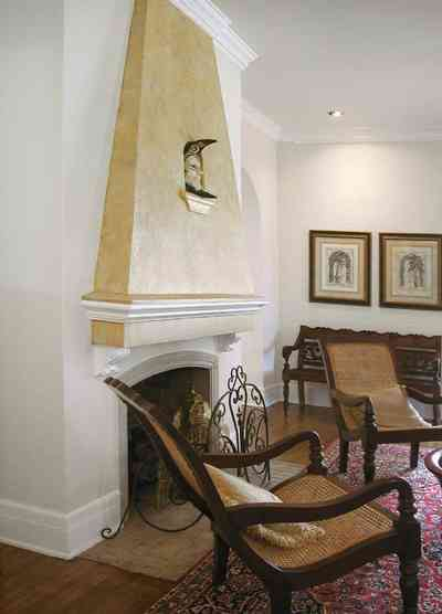 North-Hill:-123-West-Lloyd-Street_07.jpg:  fireplace, oriental rug, venetian mask, mantel, fireplace