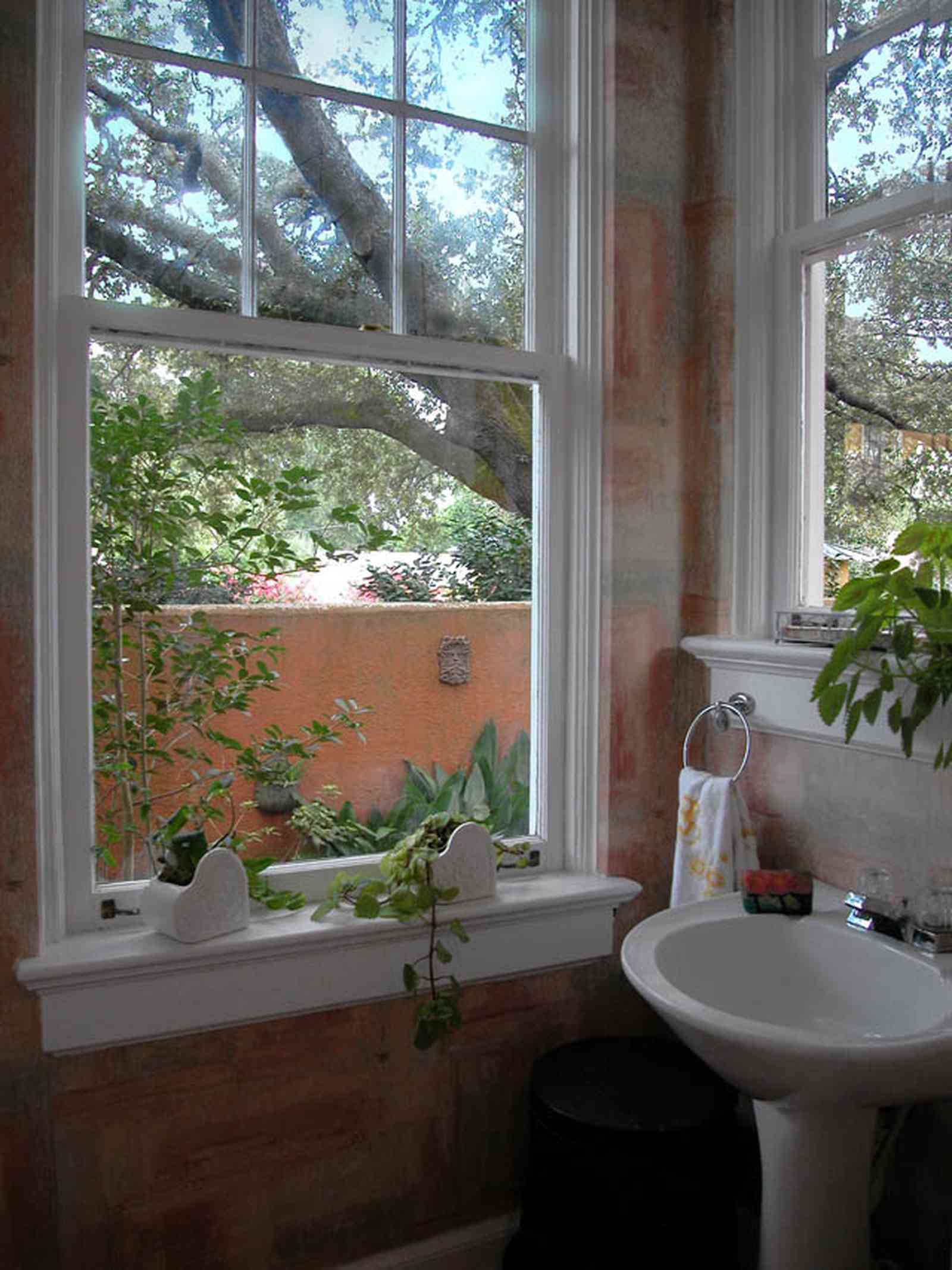 North-Hill:-123-West-Lloyd-Street_21.jpg:  bathroom, garden view, pedestal sink, oak tree, italienate style, spanish colonial revival