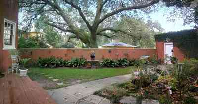 North-Hill:-123-West-Lloyd-Street_29.jpg:  backyard, garden, garage, garden house, sidewalk, stucco walls, oak trees
