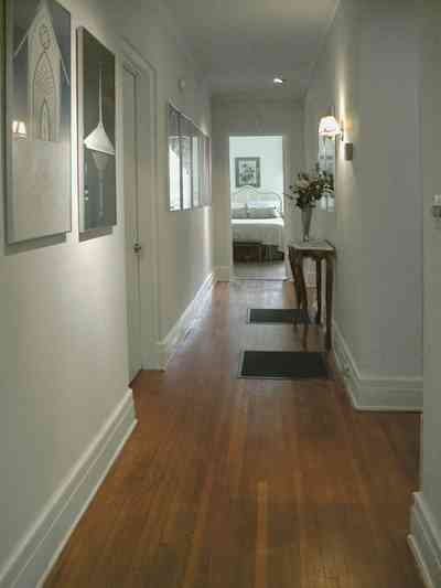 North-Hill:-123-West-Lloyd-Street_33.jpg:  hall, bedroom, heart pine flooring