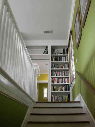 North-Hill:-123-West-Lloyd-Street_36.jpg:  stairs, master bedroom suite, railing, bannister, bookcase, library, handrail,