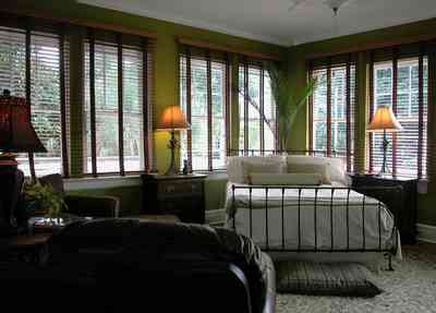 North-Hill:-123-West-Lloyd-Street_38.jpg:  master bedroom suite, venitian blinds, wooden blinds, wrought iron bed, oriental rug