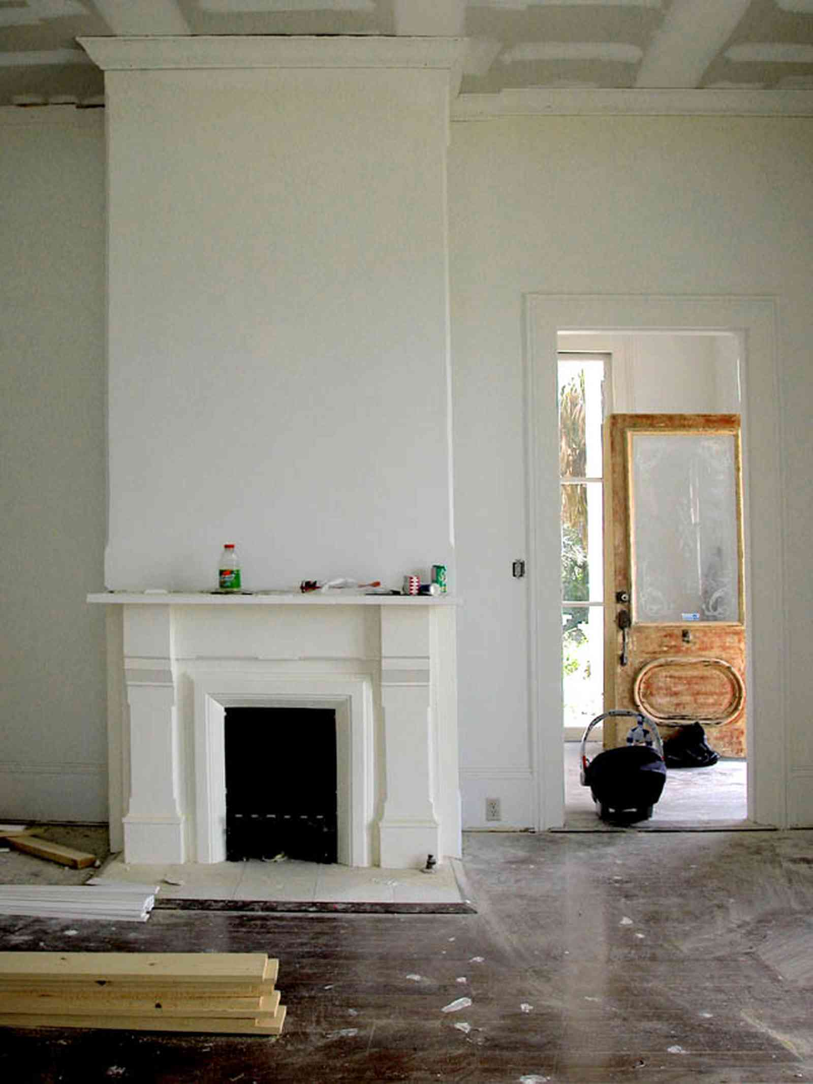 North-Hill:-200-West-Jackson-Street_03.jpg:  mantel, heart-pine floors, etched glass door, victorian structure