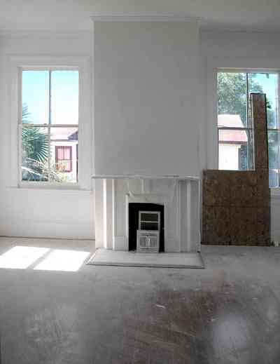 North-Hill:-200-West-Jackson-Street_33.jpg:  heart pine floor, mantle, fireplace, victorian home, casement windows, palm trees