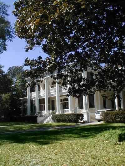 North-Hill:-204-Brainard-Street_02.jpg:  magnolia tree, ionic capitals, white house, white pillars, columns, veranda, porch, north hill preservation district