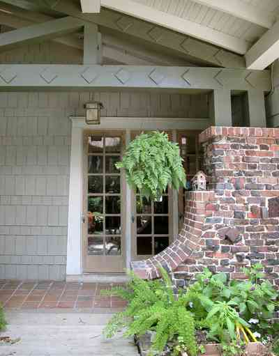 North-Hill:-284-West-Gonzales-Street_24.jpg:  side door, craftsman cottage, brick pillar, exposed beans, red tile sidewalk, ferns, birdhouse