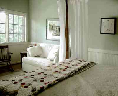 North-Hill:-284-West-Gonzales-Street_27e.jpg:  quilt, sofa, rocking chair, canopy bed, craftsman cabin
