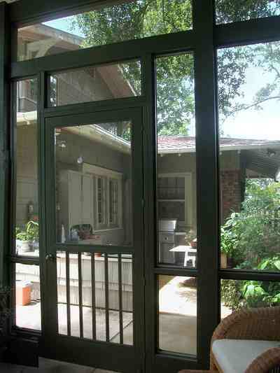North-Hill:-284-West-Gonzales-Street_28.jpg:  screened porch, wicker chair, craftsman cottage, garage apartment