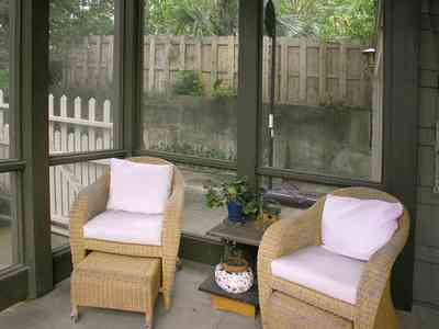 North-Hill:-284-West-Gonzales-Street_29.jpg:  wicker chairs, picket fence, screened porch, garage apartment, craftsman cottage