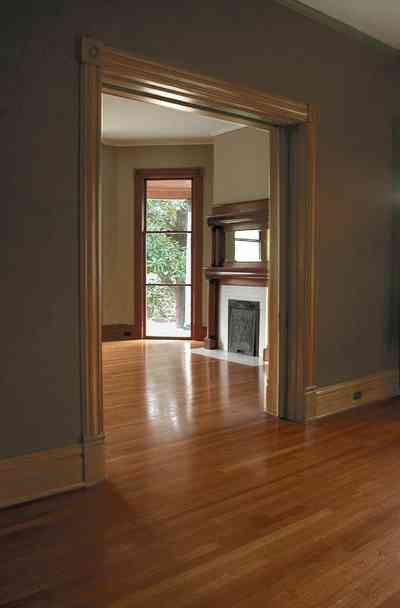North-Hill:-304-West-Gadsden-Street_17.jpg:  heartpine floors, mantle, fireplace, floor lenght windows