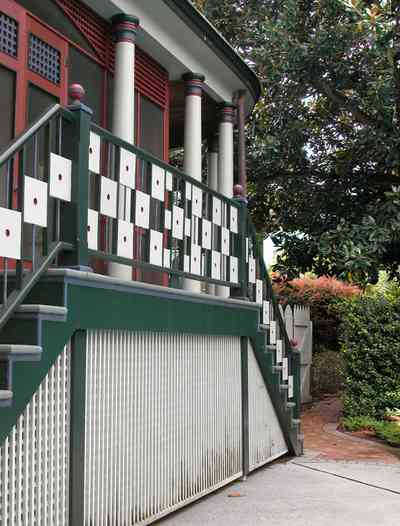 North-Hill:-304-West-Gadsden-Street_25.jpg:  lattice work, columns, porch, screen porch, stucco, magnolia tree, picket fence
