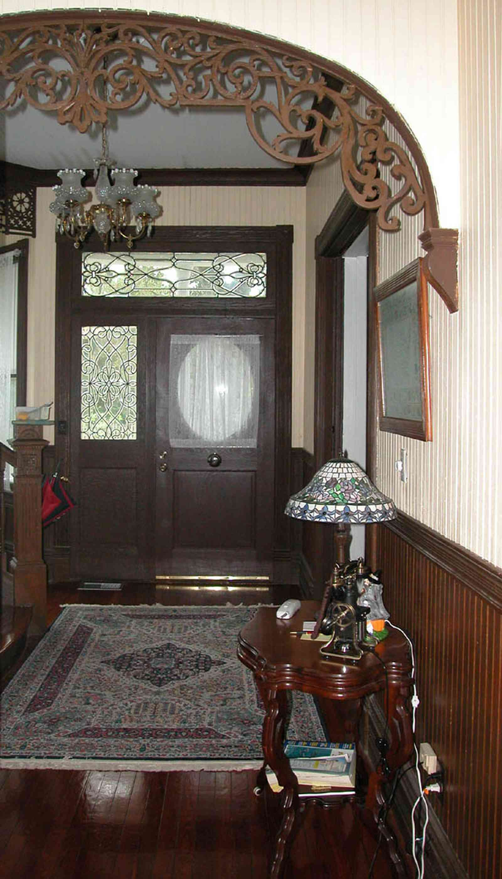 North-Hill:-52-West-Gonzalez-Street_06.jpg:  oriental rug, carved arch, tiffany lamp, beaded wall board, wooden floors, victorian home