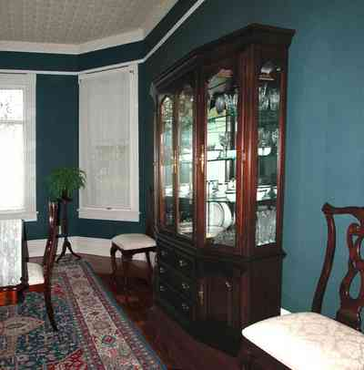North-Hill:-52-West-Gonzalez-Street_10.jpg:  oriental rug, china cabinet, crown molding, dining room table, wooden floor