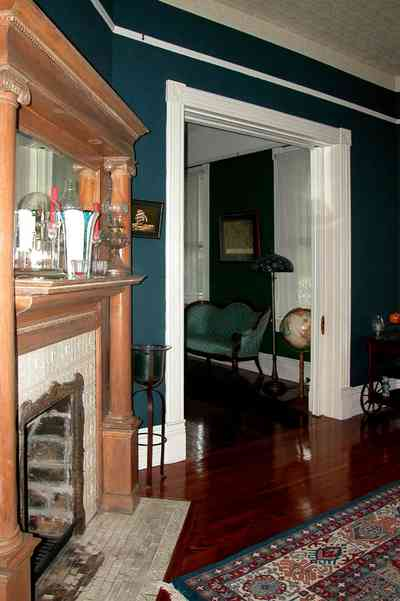 North-Hill:-52-West-Gonzalez-Street_11.jpg:  fireplace, mantel, oriental rug, dining room, victorian home, world globe, settee
