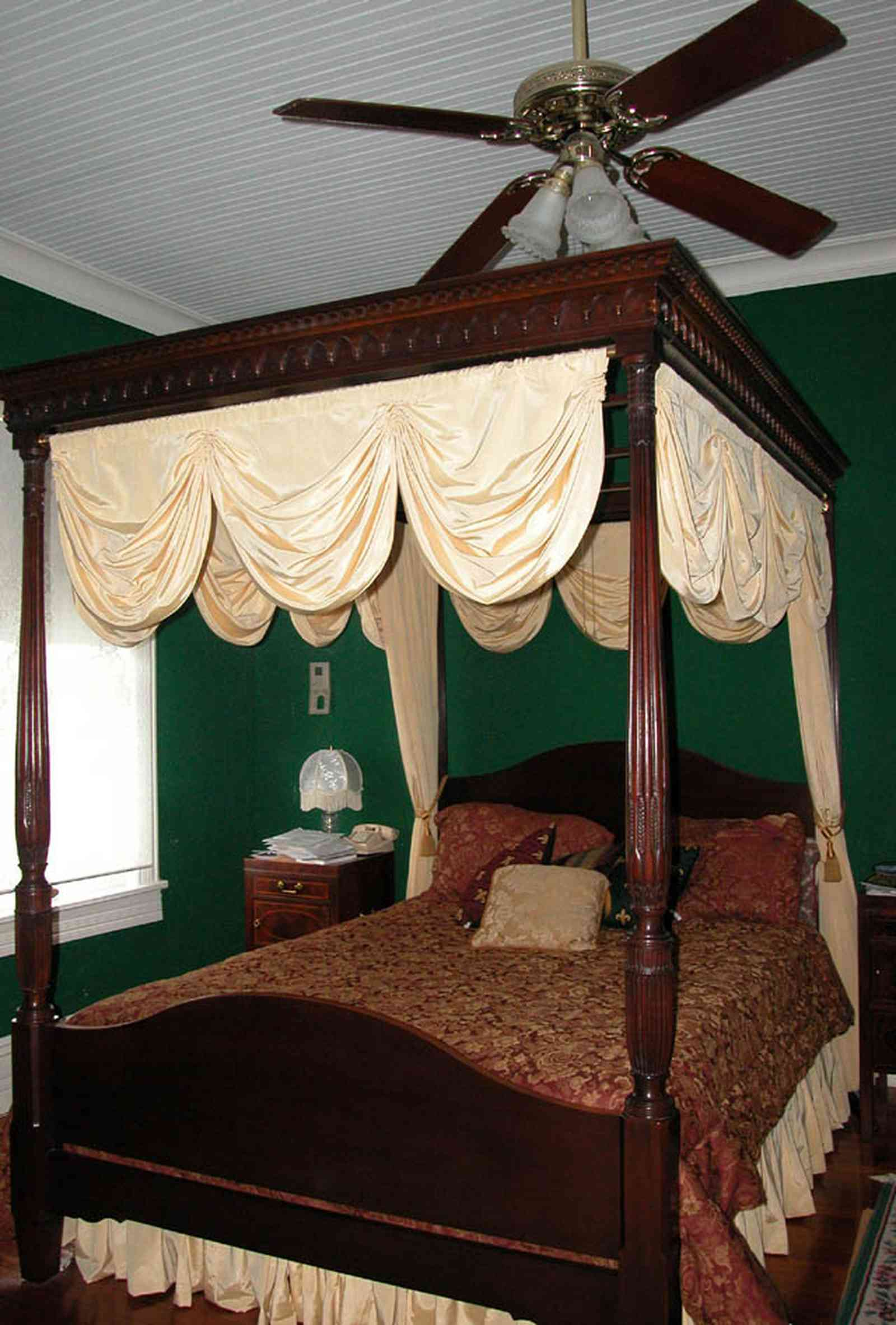 North-Hill:-52-West-Gonzalez-Street_19.jpg:  canopy bed, damask bedspread, four-poster bed, swag curtain, ceiling fan