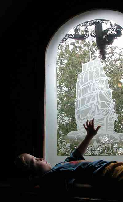 North-Hill:-52-West-Gonzalez-Street_30.jpg:  etched glass window, sailing ship, childrens room, attic, window seat
