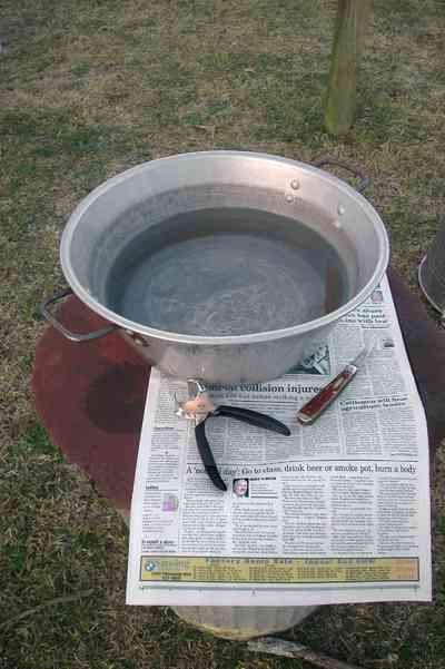 Oak-Grove:-Carpenters-Catfish-Farm_07b.jpg:  grippers, cleaning fish, fillet knife, newspaper, bowl of water, wash fish