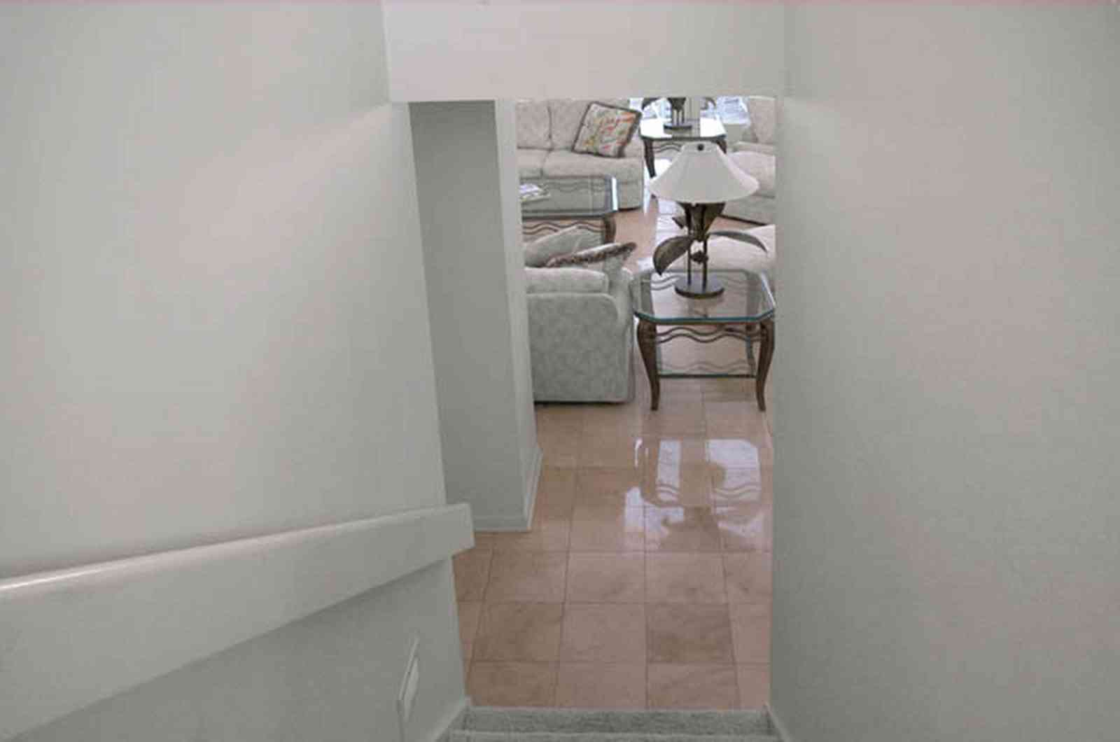 Pensacola-Beach:-1212-Ariola-Drive_14.jpg:  travitine marble floor, staircase, lamp, living room