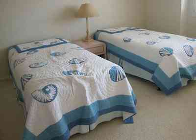 Pensacola-Beach:-1212-Ariola-Drive_21.jpg:  children's bedroom, quilt, beach house, gulf of mexico