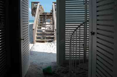 Pensacola-Beach:-1212-Ariola-Drive_28.jpg:  louvered door, steps, deck, quartz sand, emerald coast, pensacola beach, beach house