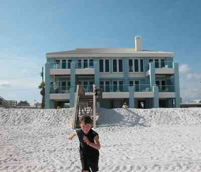 Pensacola-Beach:-1212-Ariola-Drive_32.jpg:  jonathan st. louis, glass balconies, stairs, deck, beach house, pensacola beach
