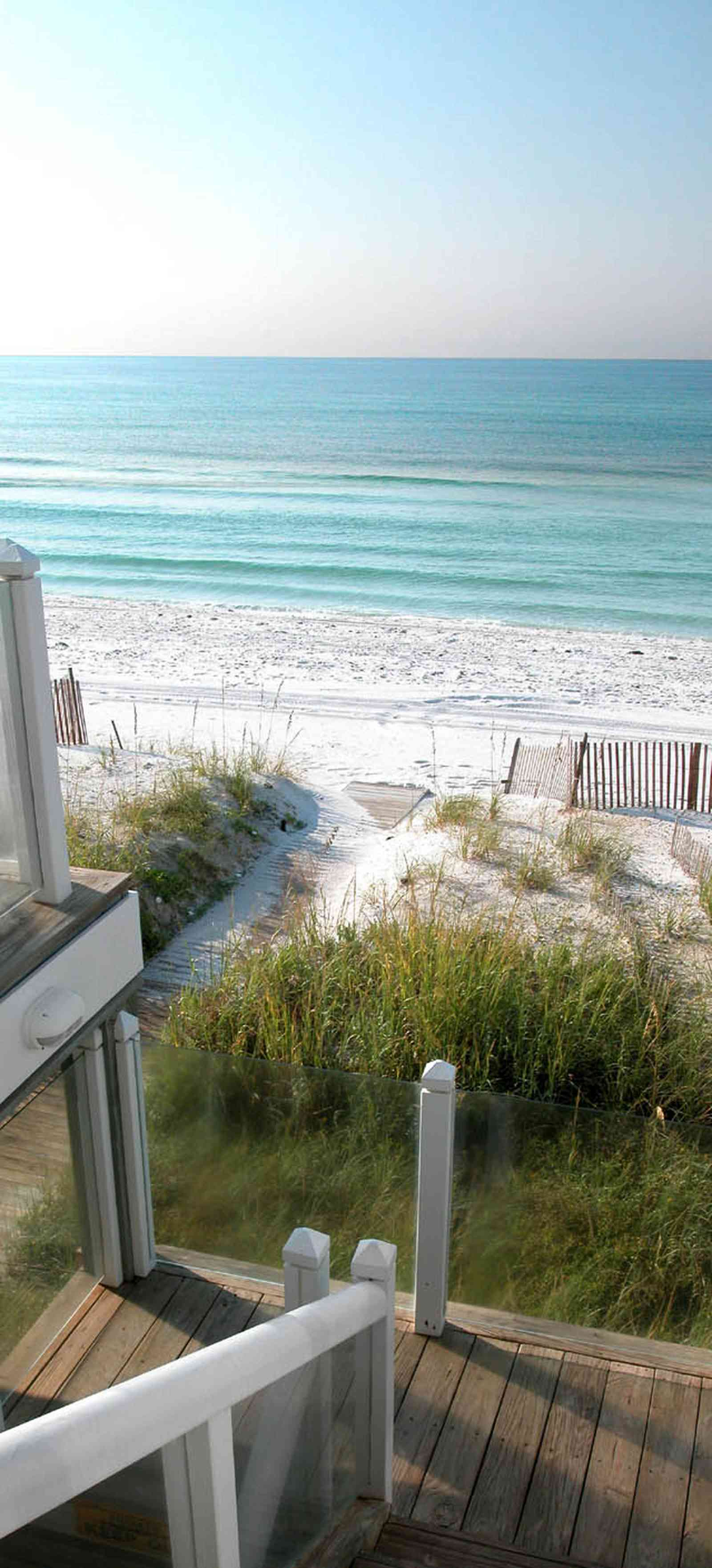 Pensacola-Beach:-Ariola-Drive-Art-Deco-House_09a.jpg:  glass balcony, sea grass, sea oats, dune, boardwalk, deck, porch, staircase, gulf of mexico, beach front house, emerald coast, pensacola beach, beachhouse, dune fence, crystal sand, white sand