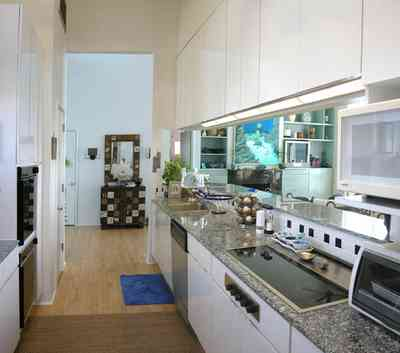 Pensacola-Beach:-Ariola-Drive-Art-Deco-House_25.jpg:  bauhaus architecture, wood floor, granite countertop, dishwasher, oven, kitchen cabinets, beachfront home, open floor plan, pensacola bay ,