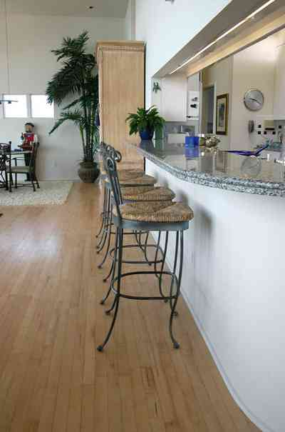 Pensacola-Beach:-Ariola-Drive-Art-Deco-House_28.jpg:  kitchen stools, kitchen counter, wood floors granite countertops, beach house, surf, beach front