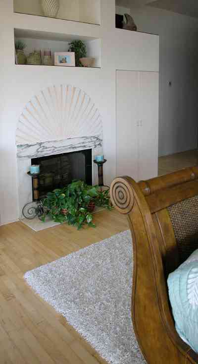 Pensacola-Beach:-Ariola-Drive-Art-Deco-House_40.jpg:  marble mantelpiece, sleigh bed, bedroom, wood floor, bedroom