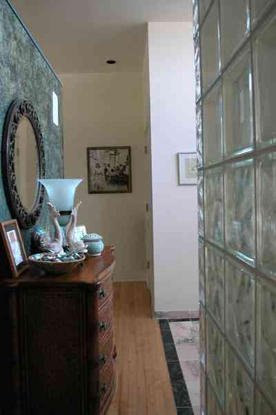 Pensacola-Beach:-Ariola-Drive-Art-Deco-House_42.jpg:  bathroom, dresser, seashell, marble floor, glass bricks, wood floor