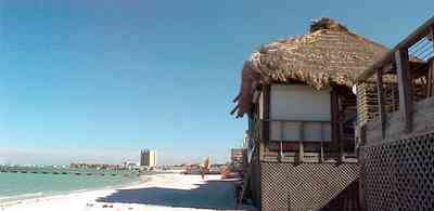 Pensacola-Beach:-Bamboo-Willies_03.jpg:  bamboo hut, tiki torch, bar, restaurant, gulf of mexico, sound, gulf coast, sand